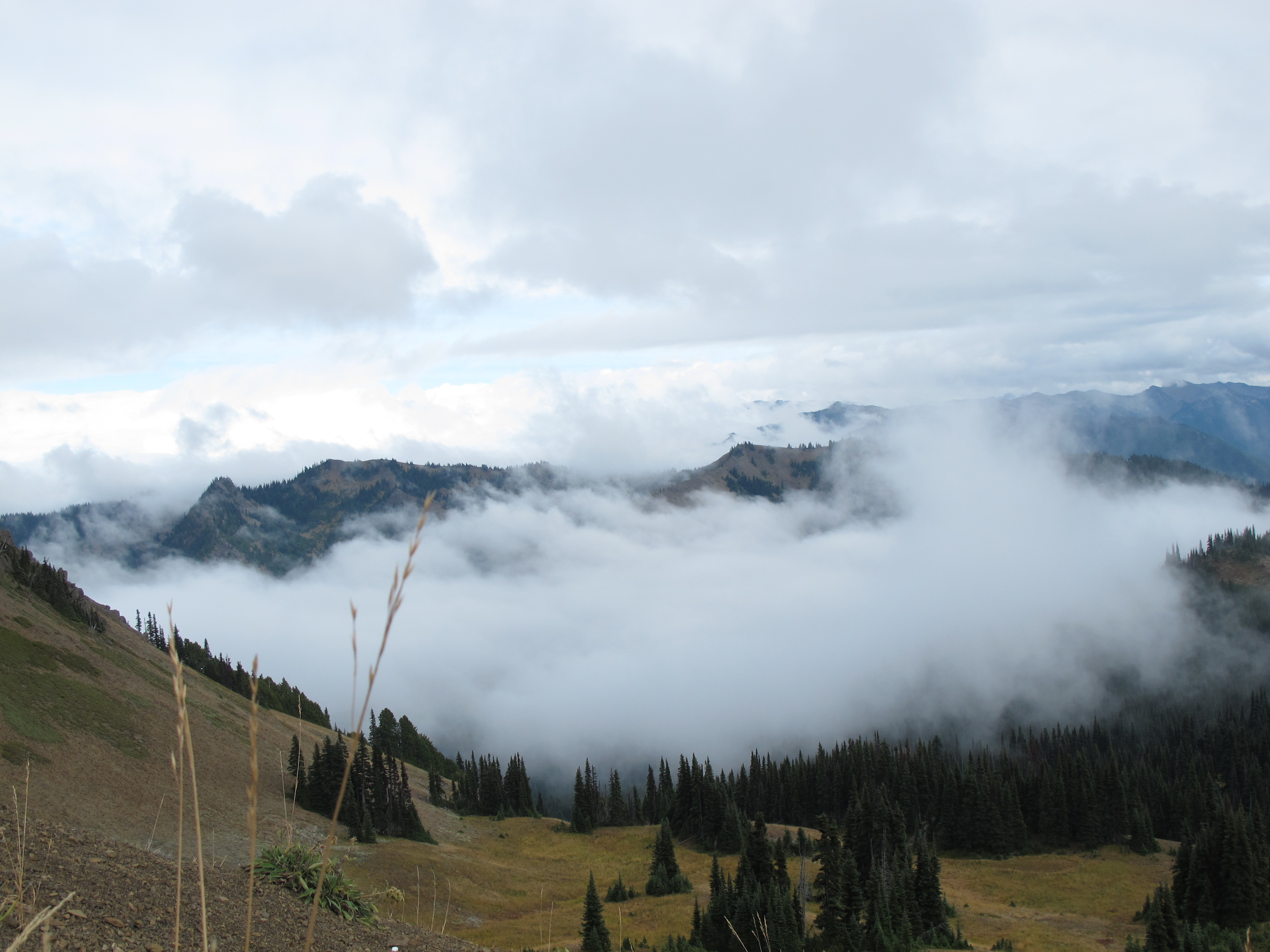 Clouds moving through mountain valleys.