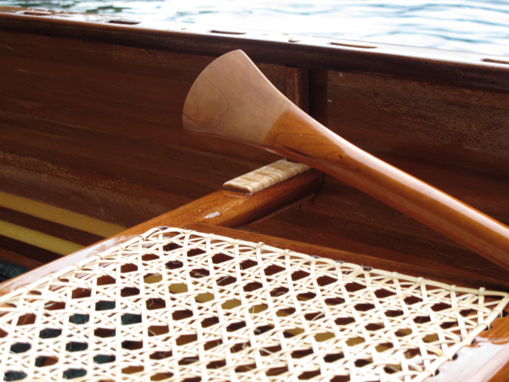 Detail of canoe seat and paddle