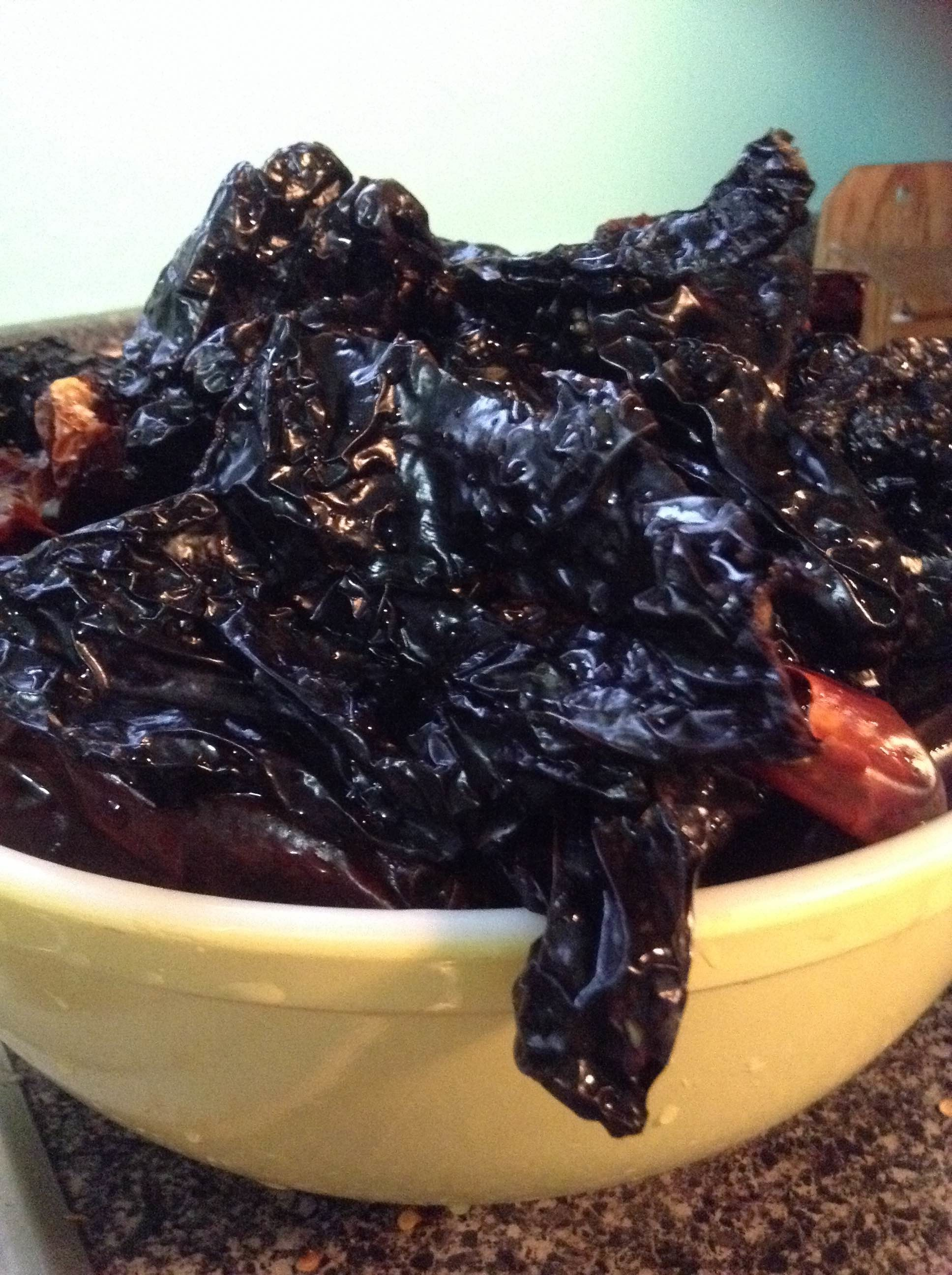Dried chiles in a bowl, waiting to be roasted